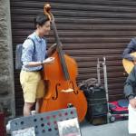 korean-bass-player-italian-street-musicians-autumn-leaves-exa